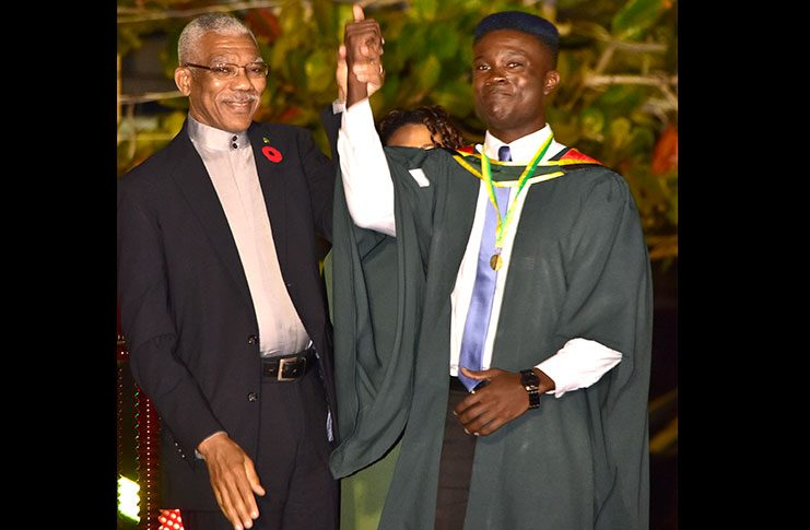 President Granger and 2016 Valedictorian Dr Kidwey Peterkin