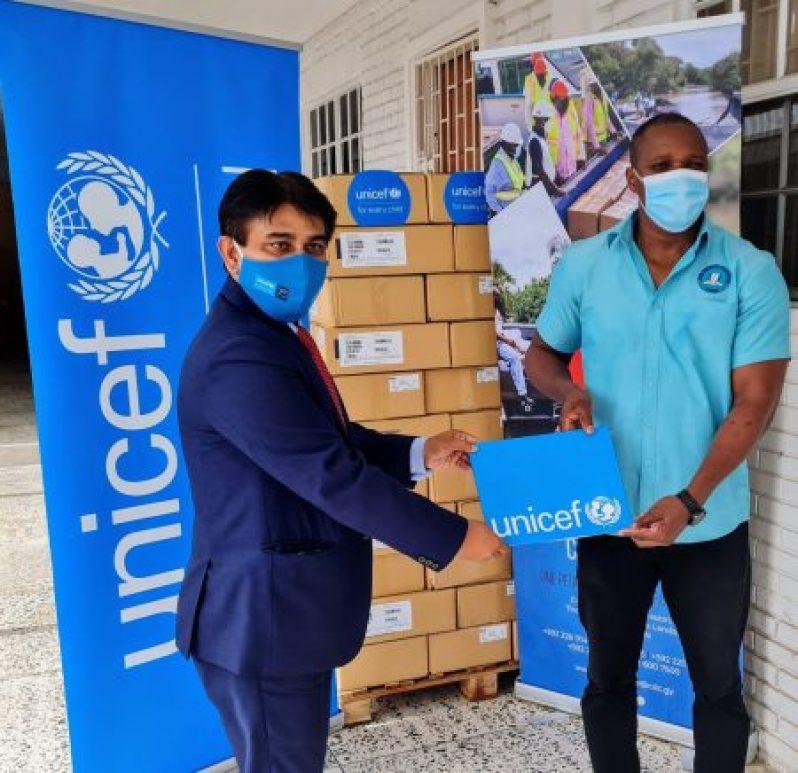 UNICEF representative, Irfan Akhtar (left) during the presentation on Tuesday (CDC photo)