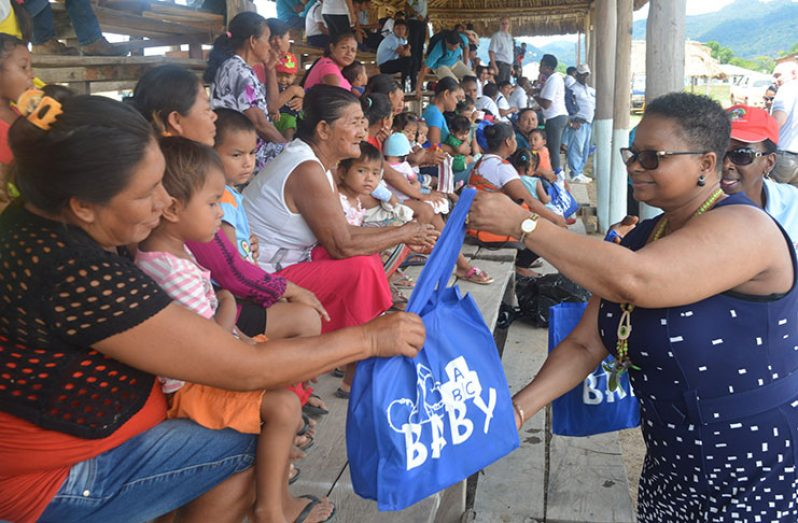 Minister of Public Health, Volda Lawrence distributes baby hampers to the mothers of Lethem, Region Nine.