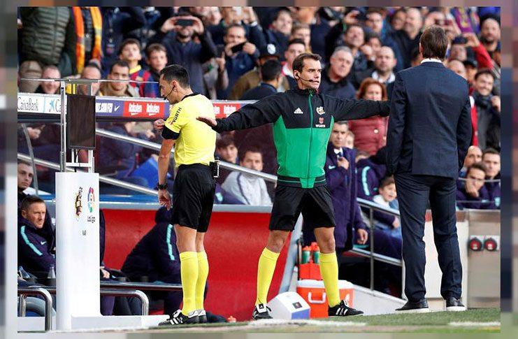Real Madrid coach Julen Lopetegui looks on as referee Jose Sanchez consults VAR before awarding a penalty. (REUTERS/Albert Gea/File photo)
