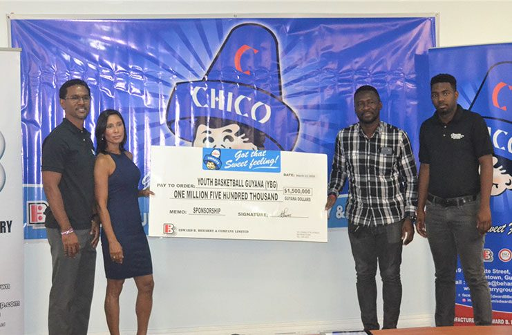 Edward B. Beharry and Company Limited's Marketing Director Anjuli Beharry-Strand (second from left), makes a presentation to Chris Bowman, co-Director of YBG.