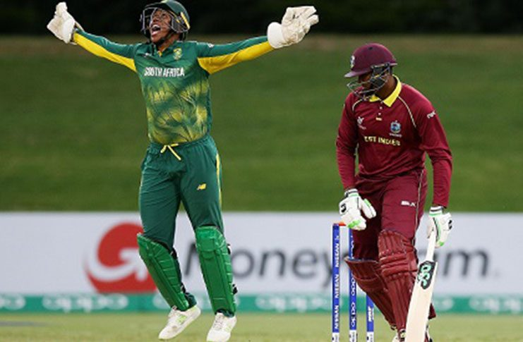West Indies batsman Bhaskar Yadram falls to a catch at the wicket and Wandile Makwetu celebrates. (Photo courtesy ICC Media)
