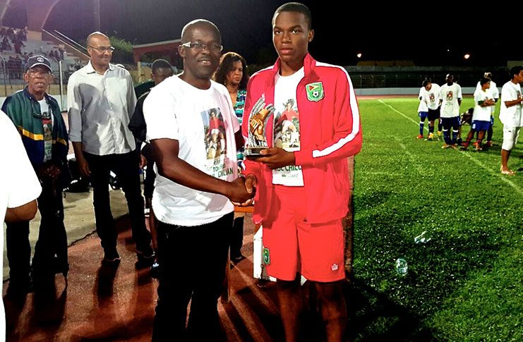 U.S -based Progressive Youths attacking midfielder Joshua Ferreira (U-17 captain) collecting the Fair Play Award at the Tournoi Paul Chillan in Martinique.