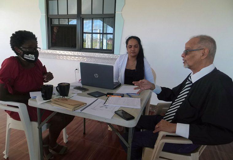 Reporter Jeune Bailey Van Keric (left) interviews Professor Daizal Samad and Ashwannie Harripersaud on the creation of their pandemic-ready classrooms