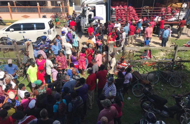 Persons receiving hampers in Berbice (SHEA photo)