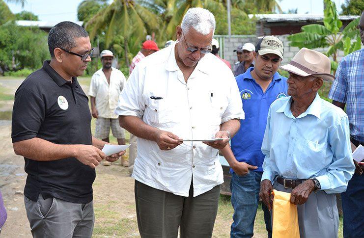 Minister Noel Holder listens to Victoria/Belfield farmers