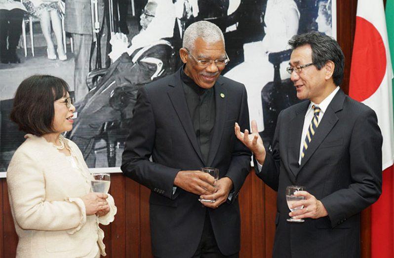 President David Granger and new Japan Ambassador to Guyana, Tatsuo Hirayama (right) and Mrs Sachiko Hirayama share a light moment at the accreditation ceremony (Ministry of Presidency photo)