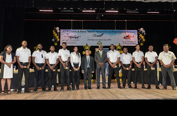 The Director General of the Guyana Civil Aviation Authority, Lieutenant Colonel (retired) Egbert Field and Minister within the Ministry of Public Infrastructure, Jaipaul Sharma along with the nine graduates who received their Guyana Civil Aviation Authority Aircraft Maintenance Engineer's Licence