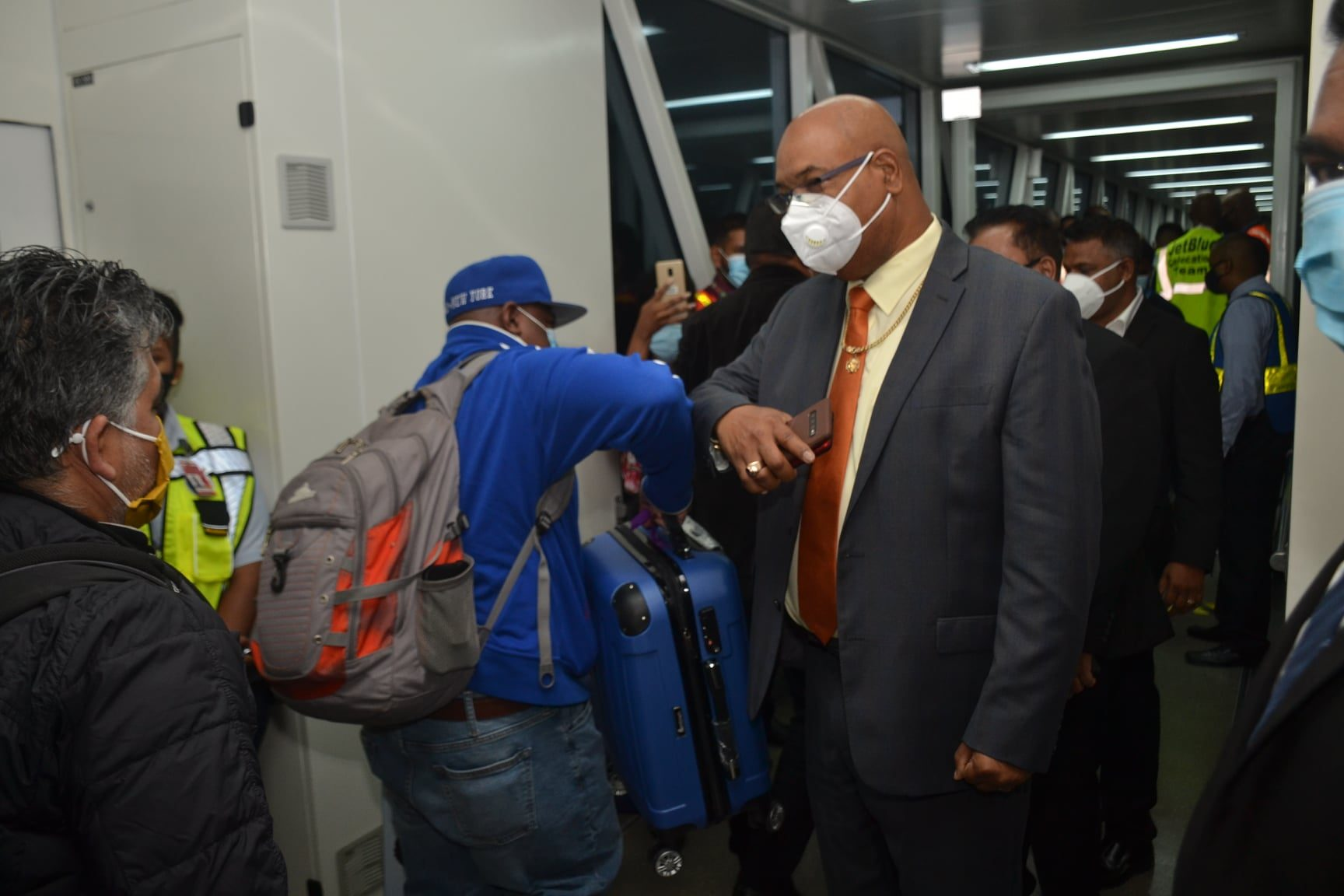 Minister of Public Works, Juan Edghill, greeting passengers that landed in Guyana on JetBlue's Inaugural Flight