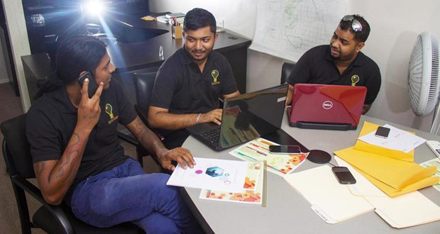 Company founding members: Seated, from left, are: Roodi Balgobin, Vickash Katwaru, and Ian Defreitas