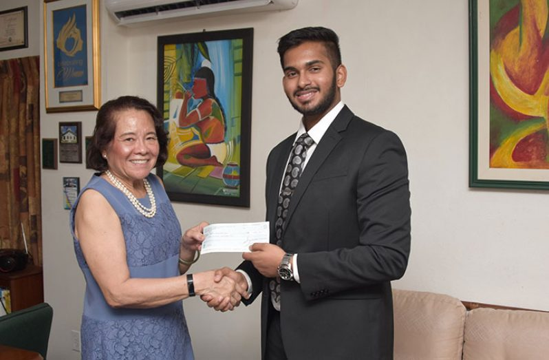 First Lady, Mrs. Sandra Granger collects a cheque from GAICO's Business Development Director, Mr. Khishan Singh. The monetary donation will go towards the work being done by the Anira Foundation
