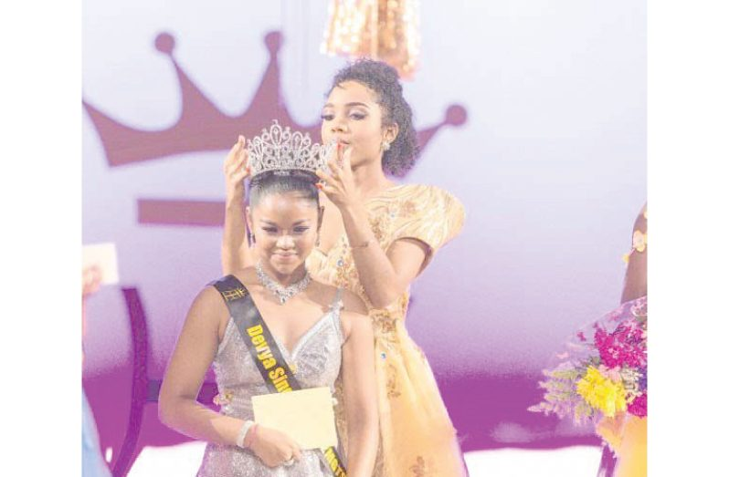 Devya Singh crowned by Miss Guyana Talented Teen 2016, Aliya Wong (Photo credit Fidal Bassier)