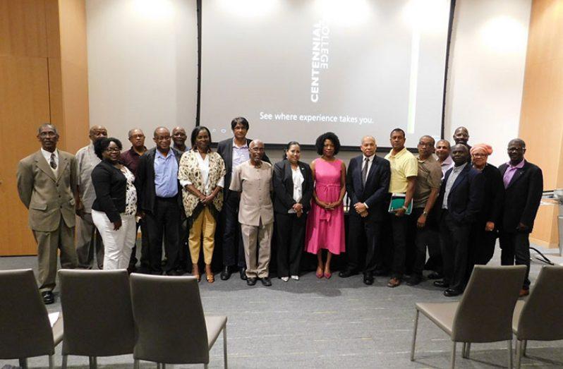 Some of the participants pose with Dr Reynolds and Registrar Dr Nigel Gravesande.