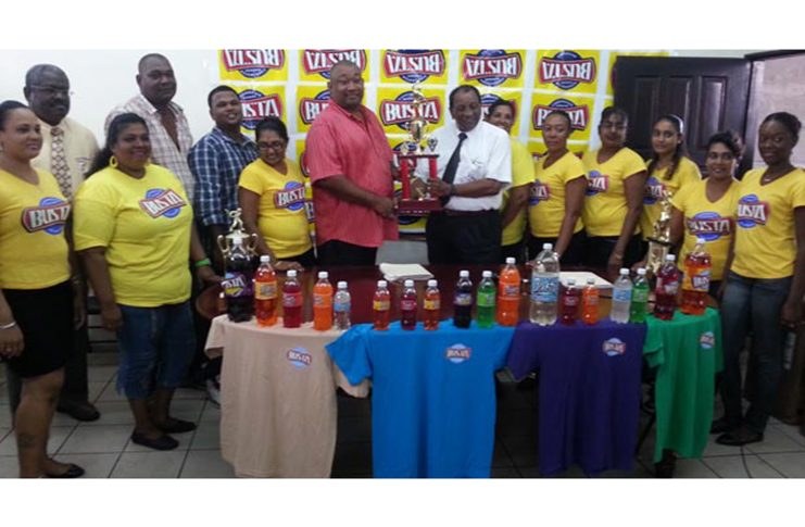 Flashback! RHTYSC president Hilbert Foster accepts the Busta Champion of Champions trophy from then GM of Guyana Beverage Inc. Robert Selman.