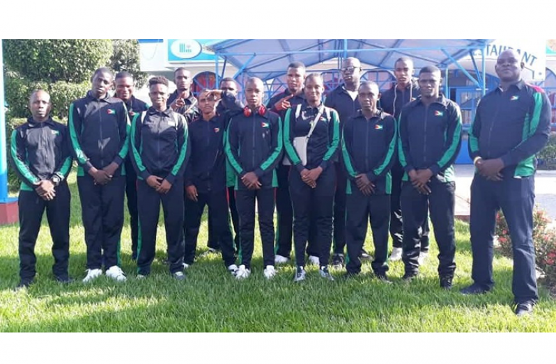 The 13 boxers and two coaches (opposite ends) will represent Guyana in T&T at the Caribbean Championships.