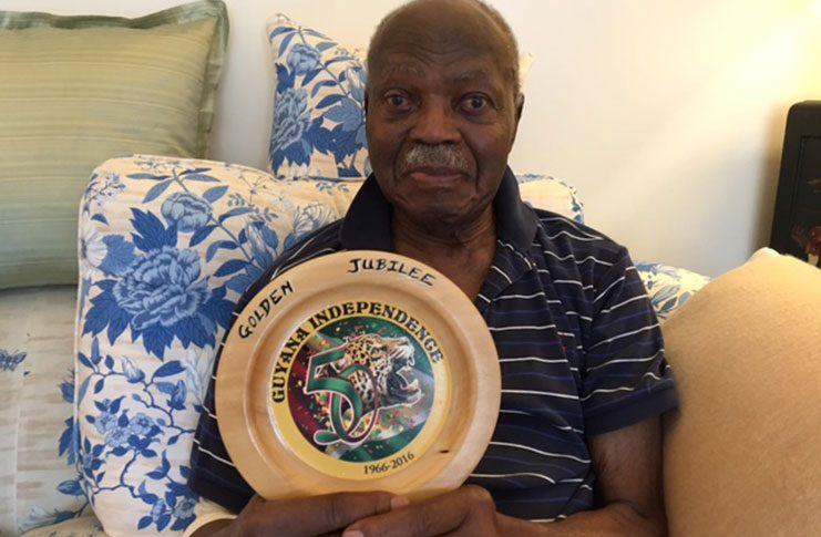 E.R Braithwaite with Guyana Jubilee Year Plaque, Made in Guyana (Francis Quamina Farrier photo)