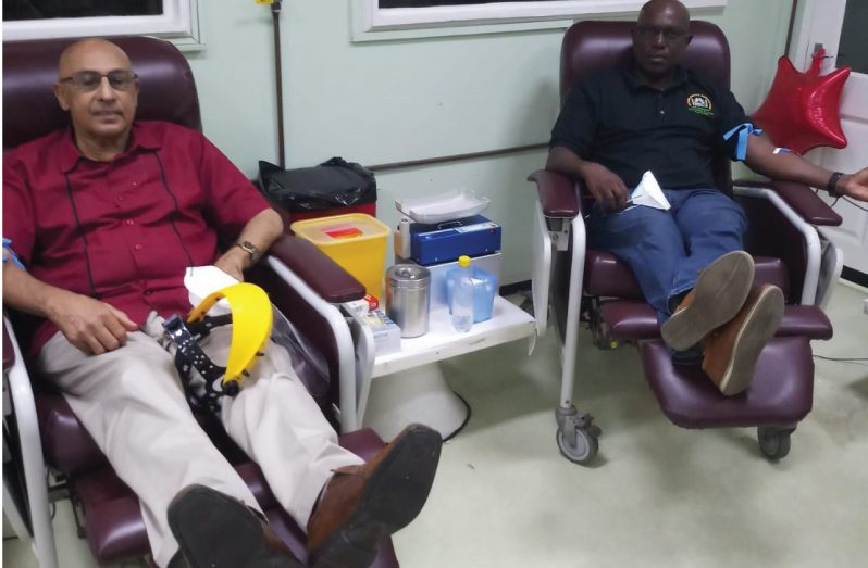 Here Yassin (left) and Ninvalle relax while donating the precious fluid.