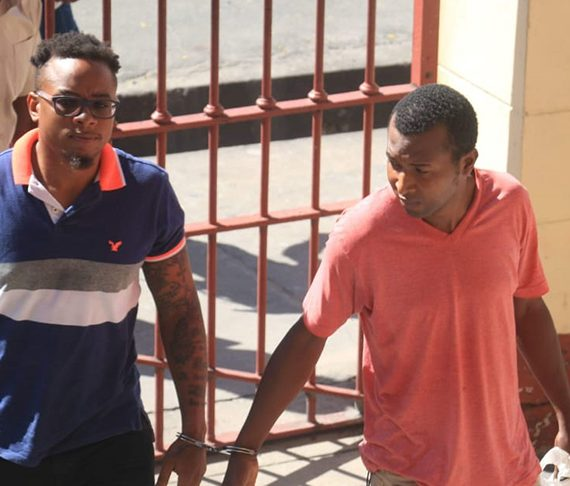 Two remanded for having unlicensed firearm